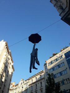 Umbrella hanging man